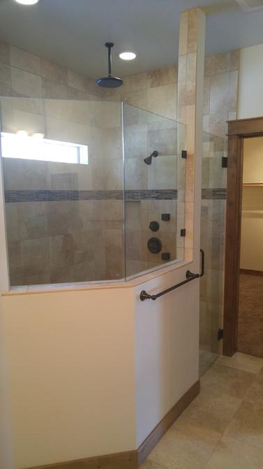 custom glass shower wall and door bronze