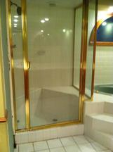 old framed glass shower door before